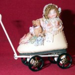Baby in Leather Shoe Wagon by Lynn McEntire