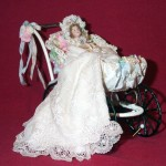 Doll in Leather Carriage by Lynn McEntire