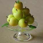 Apples on Glass Stand by Teresa Martinez