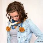 Long Skinny Knitted Scarf With Pom Poms by Maya