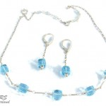 Silver And Blue Topaz Jewelry Set by Rita Sunderland
