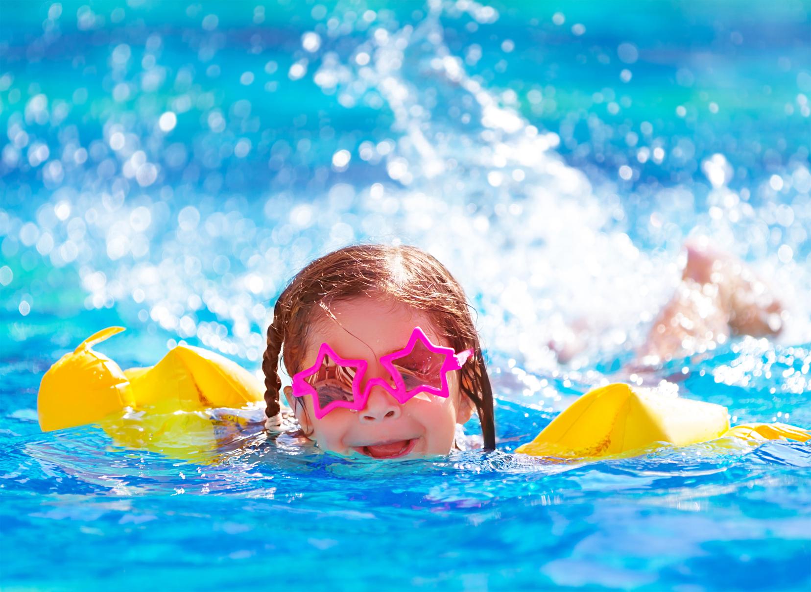 Cute arabic girl in the pool