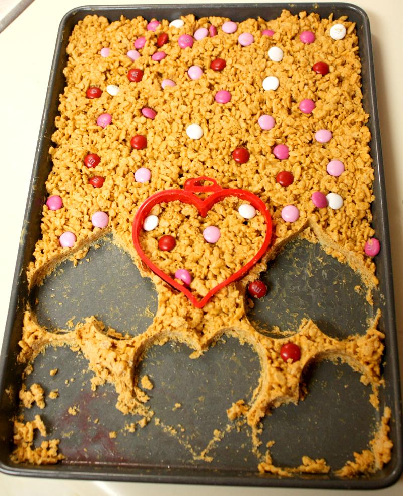 Peanut Butter Butterscotch Heart Shaped Rice Krispie Bars Cutting